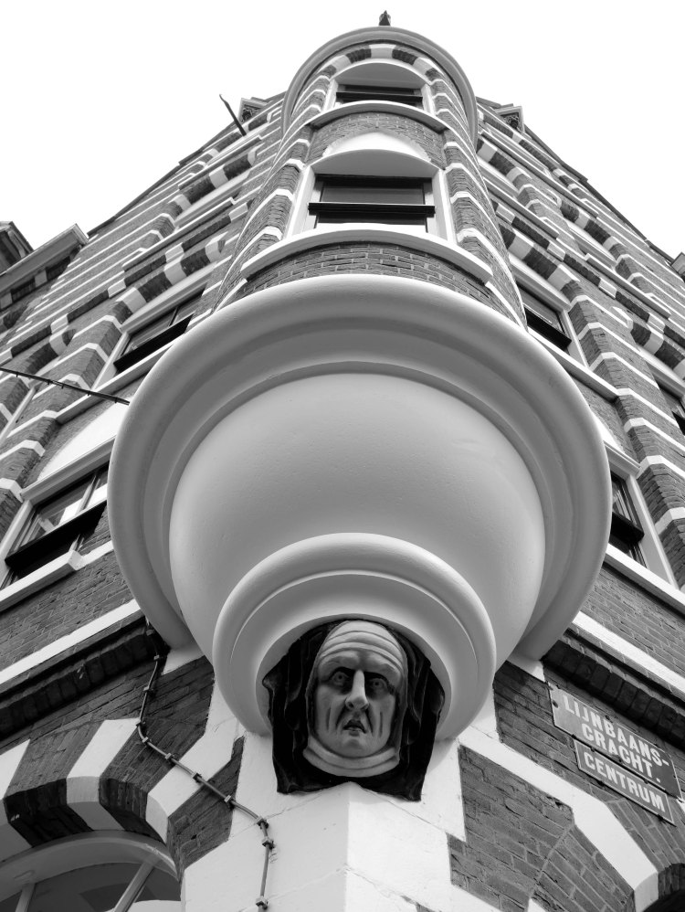 Bottom view of an Amsterdam house, a man face is carved in the corner