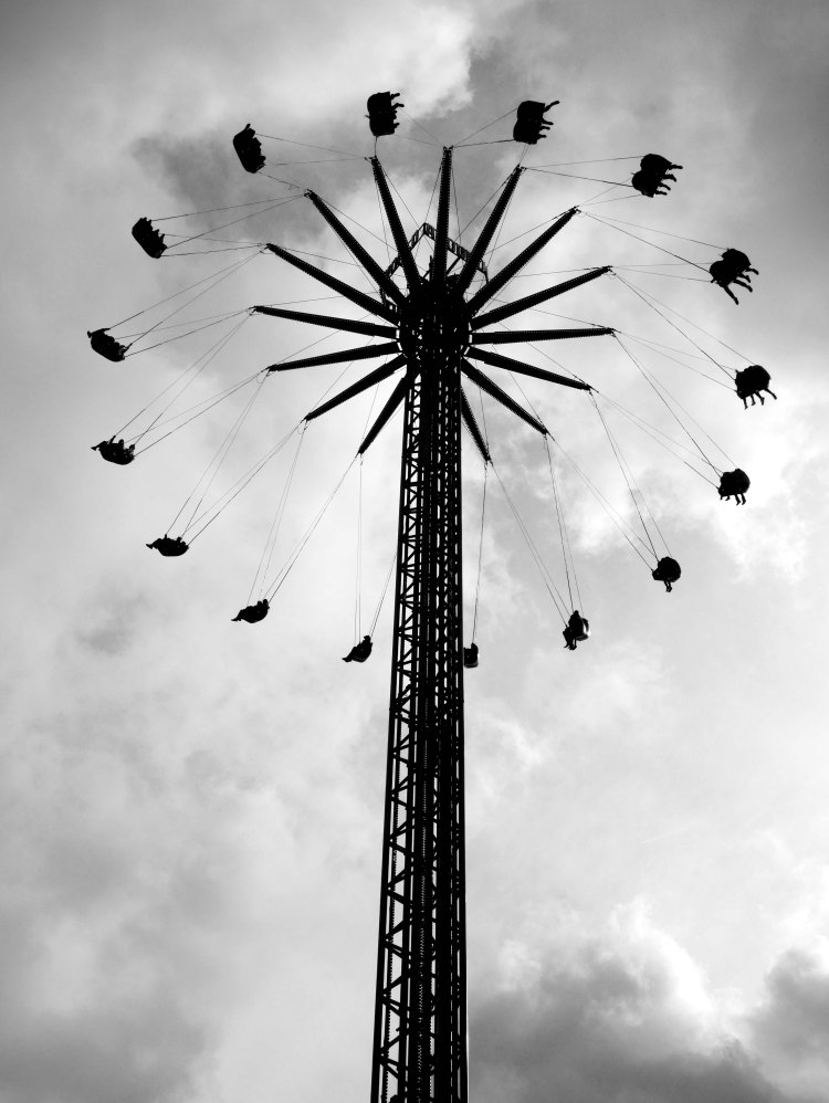 Bottom view of a swing ride in Amsterdam on a cloudy day