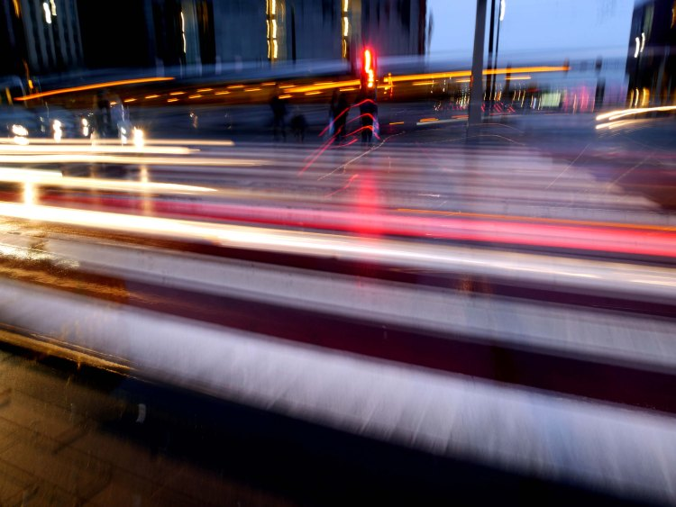 Red, white and orange lights of cars on the road at nightfall in Rotterdam - the Netherlands