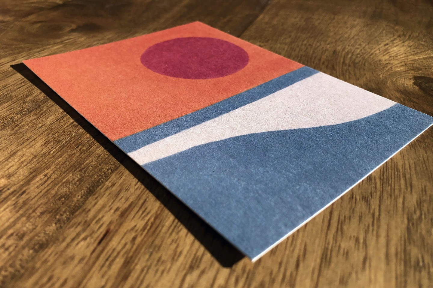 Colorful postcard on a wooden table