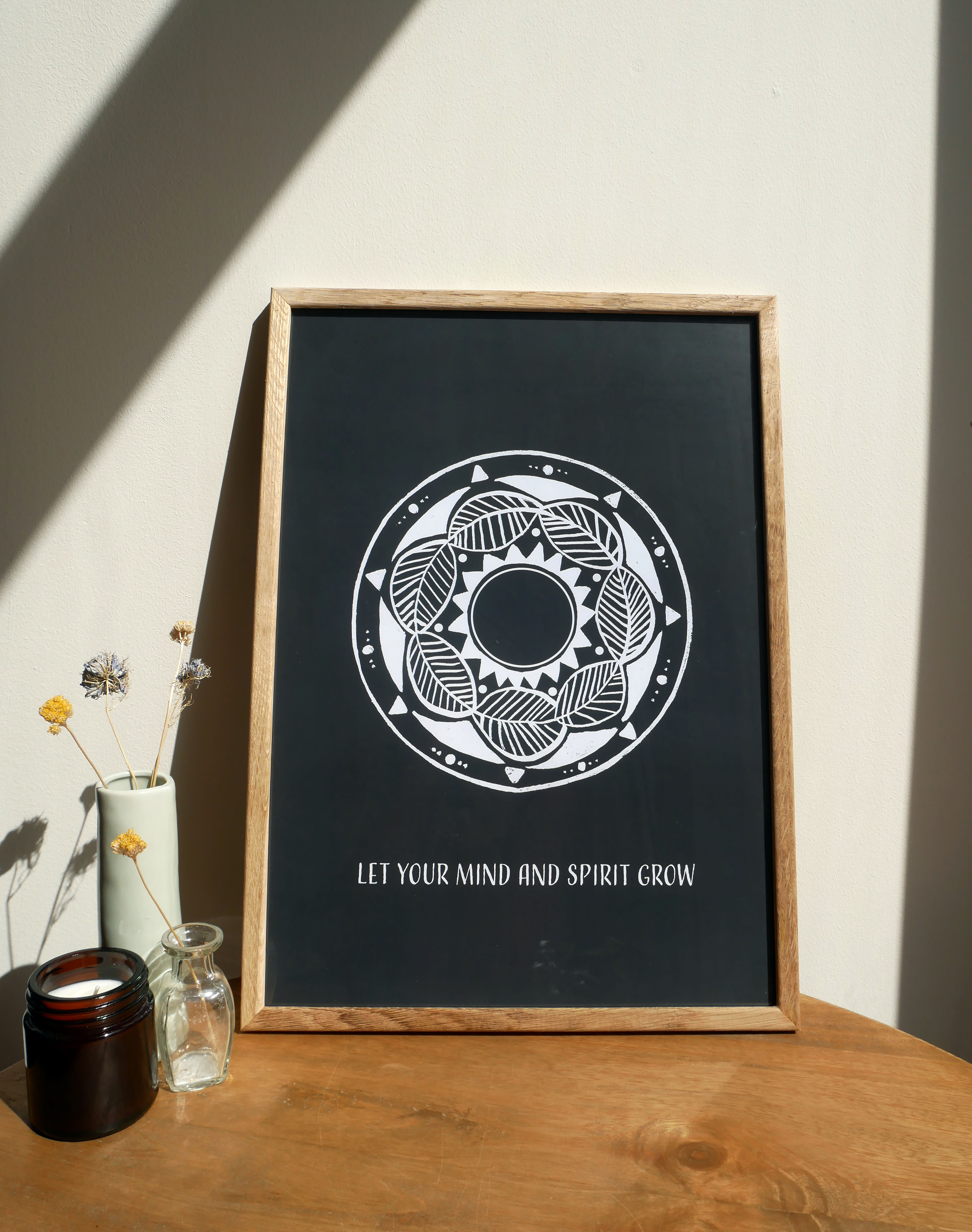 Mandala-style poster in a wooden frame