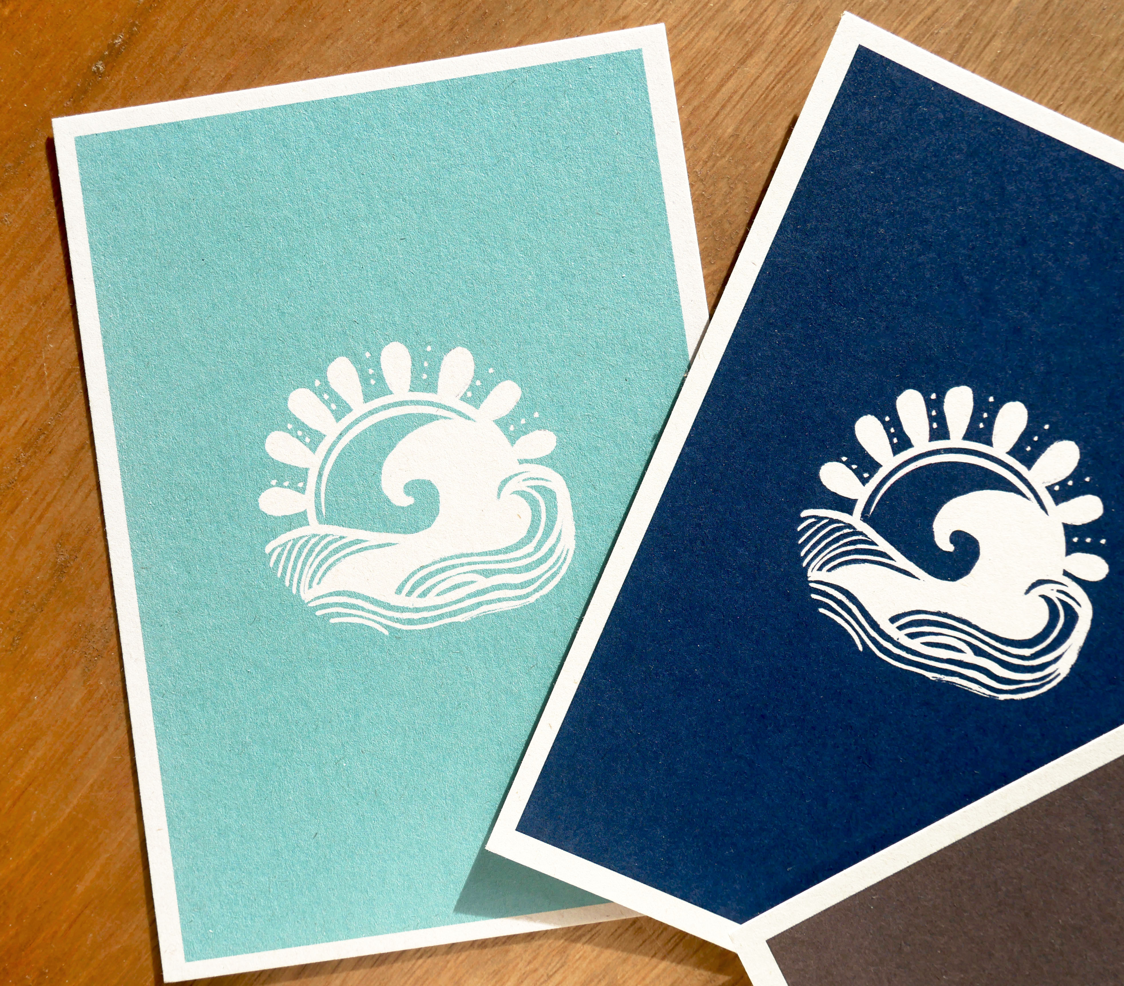 Tiffany Blue and Navy Blue Postcards representing a white wave in a white sun